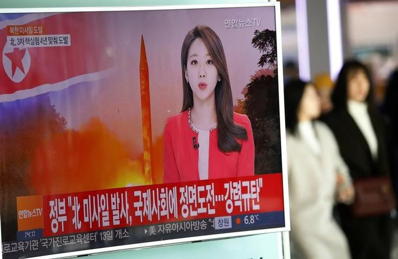 Women walk past a TV screen broadcasting a news report on North Korea firing a ballistic missile into the sea off its east coast, at a railway station in Seoul, South Korea, February 12, 2017.  REUTERS/Kim Hong-Ji
