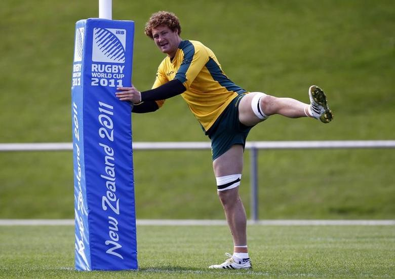 Australia Wallabies' Scott Higginbotham stretches during a training session in Wellington October 7, 2011. The Wallabies will play against South Africa Springboks in their Rugby World Cup quarter-final match in Wellington on Sunday.  REUTERS/David Gray