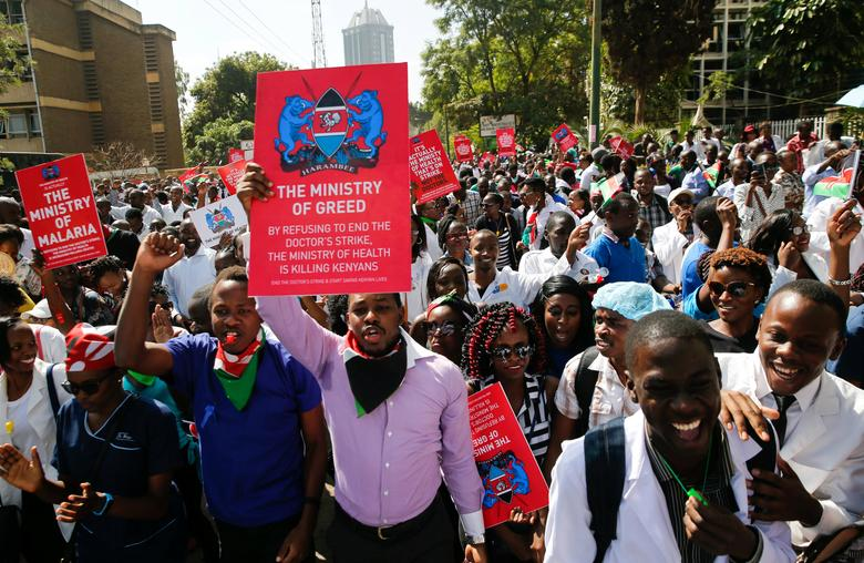 Kenyan doctors carry placards as they chant slogans to demand fulfilment of a 2013 agreement between their union and the government that would raise their pay and improve working conditions outside the employment and labour relations courts in Nairobi, Kenya, January 26, 2017. REUTERS/Thomas Mukoya