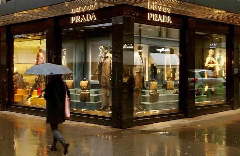 Italian luxury fashion house Prada's logo is seen at a store in Zurich, Switzerland October 26, 2016.   REUTERS/Arnd Wiegmann