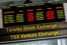 A sign board displaying Toronto Stock Exchange (TSX) stock information is seen in Toronto June 23, 2014.  Canada's main stock index was little changed on Monday as weakness in financial and energy shares offset gains in the materials sector.   REUTERS/Mark Blinch