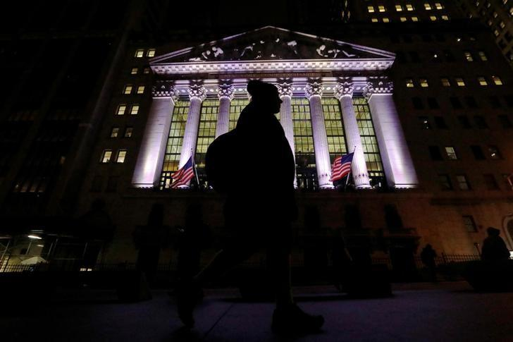 A commuter passes by the New York Stock Exchange (NYSE) in the financial district in New York City, U.S., February 7, 2017. REUTERS/Brendan McDermid
