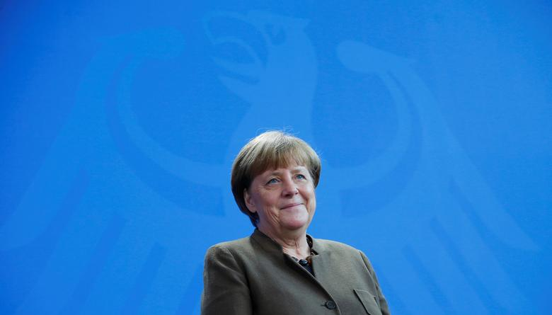 German Chancellor Angela Merkel attends a presentation of a newly designed 2-Euro coin at the Chancellery in Berlin, Germany February 10, 2017. REUTERS/Hannibal Hanschke