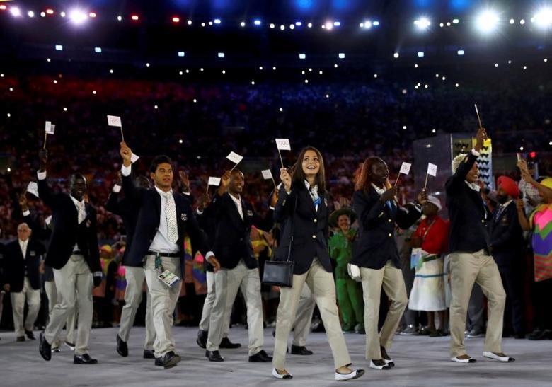 2016 Rio Olympics - Opening Ceremony - Maracana - Rio de Janeiro, Brazil - 05/08/2016. The Refugee Olympic Athletes' team arrives for the opening ceremony. REUTERS/Kai Pfaffenbach