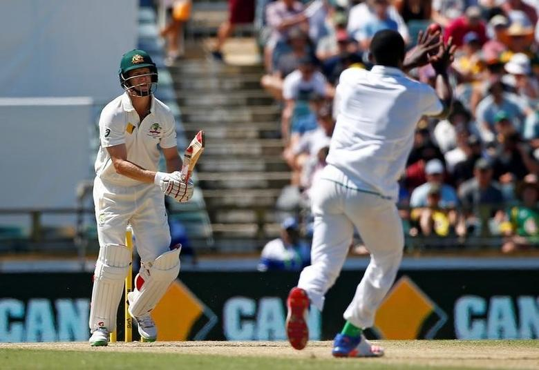 Cricket - Australia v South Africa - First Test cricket match - WACA Ground, Perth, Australia - 4/11/16. South Africa's Kagiso Rabada reaches to take a catch to dismiss Australia's Adam Voges at the WACA Ground in Perth.    REUTERS/David Gray