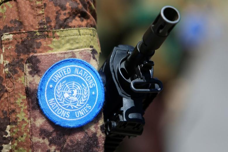 The weapon of a peacekeeper of the United Nations Interim Force in Lebanon (UNIFIL) is pictured during a handover ceremony from Italian Major-General Luciano Portolano to Irish Major-General Michael Bearyover the command of Lebanon's U.N. peacekeeping forces at the United Nations headquarters in Naqoura, southern Lebanon, July 19, 2016. REUTERS/Ali Hashisho