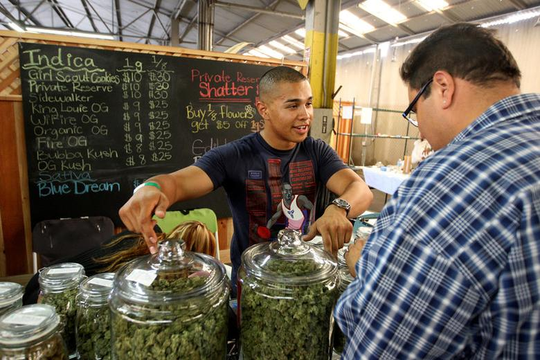 File Photo: Grower Anthony Nguyen sells marijuana at the medical marijuana farmers market at the California Heritage Market in Los Angeles, California July 11, 2014.  REUTERS/David McNew/File Photo