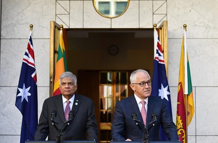Sri Lanka's Prime Minister Ranil Wickremesinghe (L) and Australia's Prime Minister Malcolm Turnbull attend a press conference at Parliament House in Canberra, Australia, February 15, 2017.  AAP/Mick Tsikas/via REUTERS