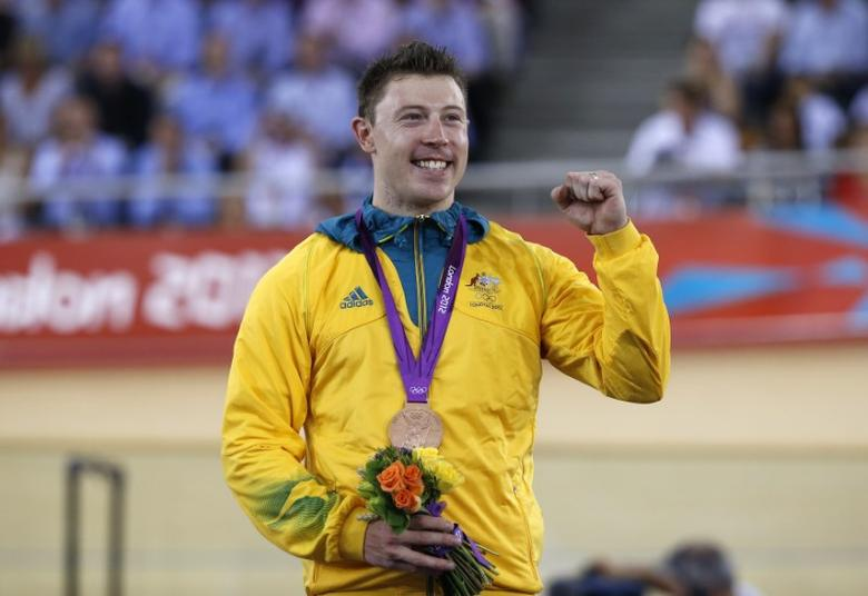 Australia's bronze medallist Shane Perkins stands with his medal during the victory ceremony after the track cycling men's sprint finals at the Velodrome during the London 2012 Olympic Games August 6, 2012.    REUTERS/Paul Hanna