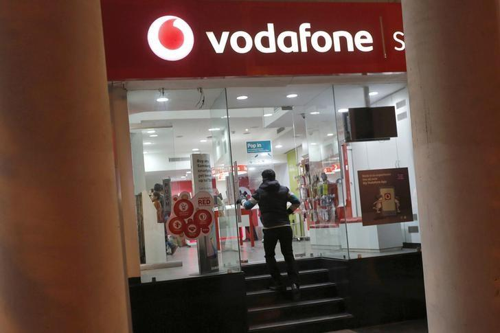 FILE PHOTO -  A customer enters a Vodafone store in New Delhi, India, December 29, 2015.  RETUERS/Adnan Abidi/File Photo