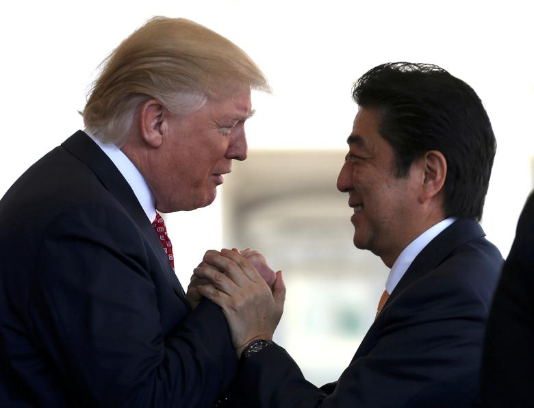 Japanese Prime Minister Shinzo Abe is greeted by President Donald Trump ahead of their joint news conference at the White House, February 10, 2017. REUTERS/Joshua Roberts