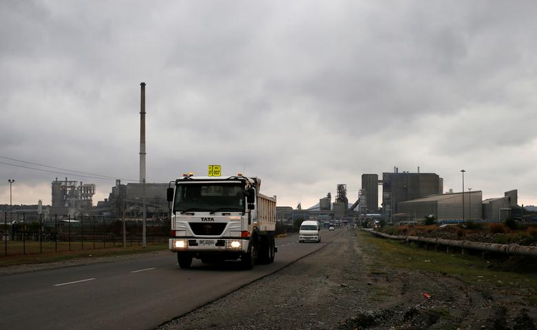 Trucks leave an Anglo American Platinum (AMPLATS) processing plant near Rustenburg, South Africa October 12, 2012. REUTERS/Mike Hutchings/File Photo