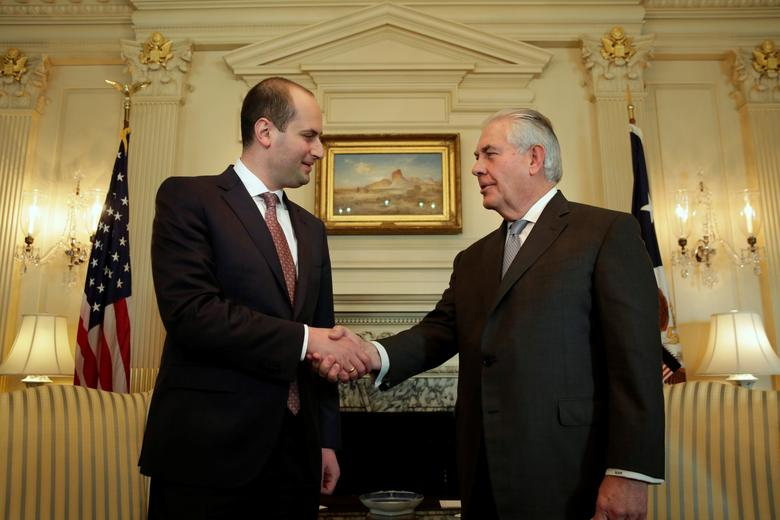 U.S. Secretary of State Rex Tillerson (R) shakes hands with Georgian Foreign Minister Mikheil Janelidze before their meeting at the State Department in Washington, U.S., February 10, 2017. REUTERS/Yuri Gripas