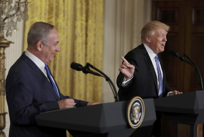 U.S. President Donald Trump (R) laughs with Israeli Prime Minister Benjamin Netanyahu at a joint news conference at the White House in Washington, U.S., February 15, 2017. REUTERS/Kevin Lamarque