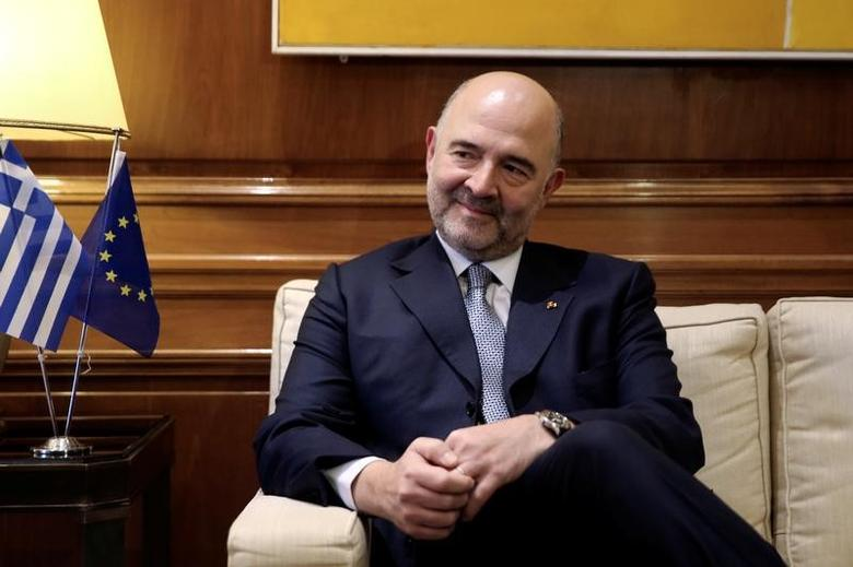 European Economic and Financial Affairs Commissioner Pierre Moscovici meets with Greek Prime Minister Alexis Tsipras (not pictured) at the Maximos Mansion in Athens, Greece February 15, 2017. REUTERS/Alkis Konstantinidis