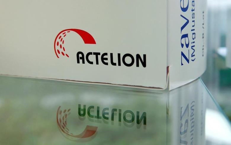 Swiss biotech company Actelion's logo is seen on a dummy package of medication displayed at the company's headquarters in Allschwil, Switzerland January 26, 2017. REUTERS/Arnd Wiegmann - RTSXGYJ