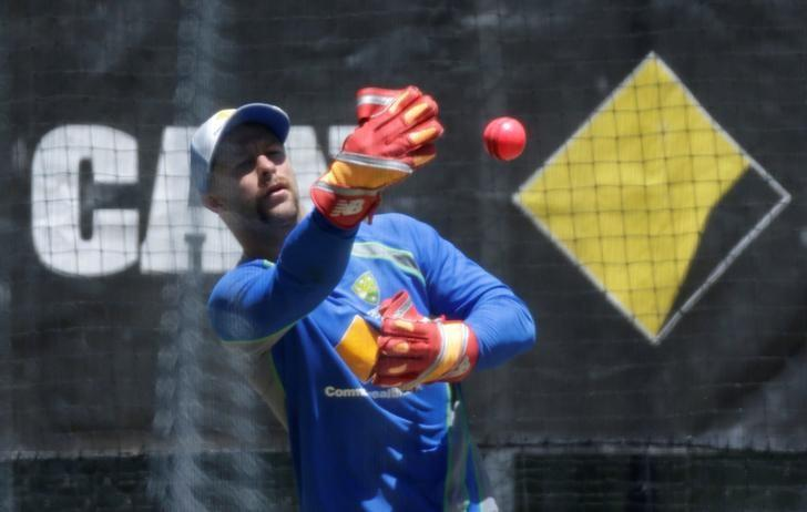 Cricket - Australia v South Africa - Third Test cricket match - Adelaide Oval, Adelaide, Australia - 23/11/16. Australian wicketkeeper Matthew Wade tosses back a pink ball during a training session the eve of the third test against South Africa.    REUTERS/Jason Reed