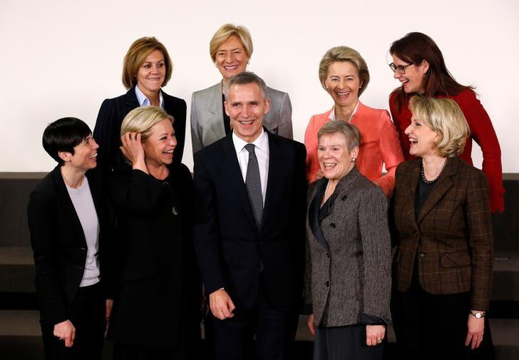 NATO Secretary-General Jens Stoltenberg poses with (L-R 1st Row) Norway's Defence Minister Ine Marie Eriksen Soreide, Dutch Defence Minister Jeanine Hennis-Plasschaert, NATO deputy secretary-general Rose Gottemoeller, Albania's Defence Minister Mimi Kodheli, (L-R 2nd Row) Spain's Defence Minister Maria Dolores de Cospedal, Italian Defence Minister Roberta Pinotti, German Defence Minister Ursula von der Leyen and Slovenia's Defence Minister Andreja Katic during a NATO defence ministers meeting at the Alliance's headquarters in Brussels, Belgium February 15, 2017. REUTERS/Francois Lenoir
