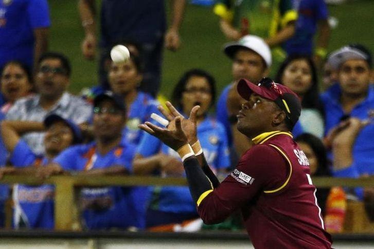 West Indies Marlon Samuels catches out India's batsman Ravindra Jadeja during their Cricket World Cup match in Perth, March 6, 2015. REUTERS/David Gray/Files