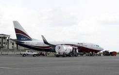 A Boeing 737-7BD Arik Air aeroplane is seen parked on the tarmac at the local airport in Lagos, file. REUTERS/Akintunde Akinleye