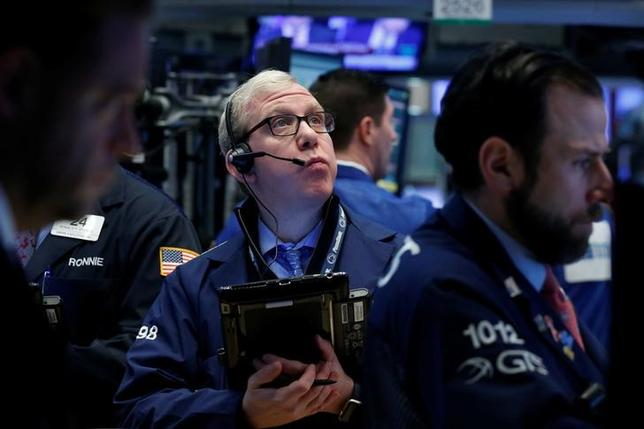 Traders work on the floor of the New York Stock Exchange (NYSE) in New York, U.S., February 16, 2017. REUTERS/Brendan McDermid