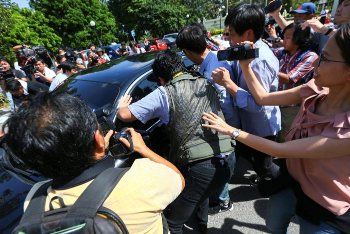 Members of the media chase a North Korean official car to ask questions at the Foreign Ministry in Putrajaya, Malaysia, February 20, 2017. REUTERS/Athit Perawongmetha