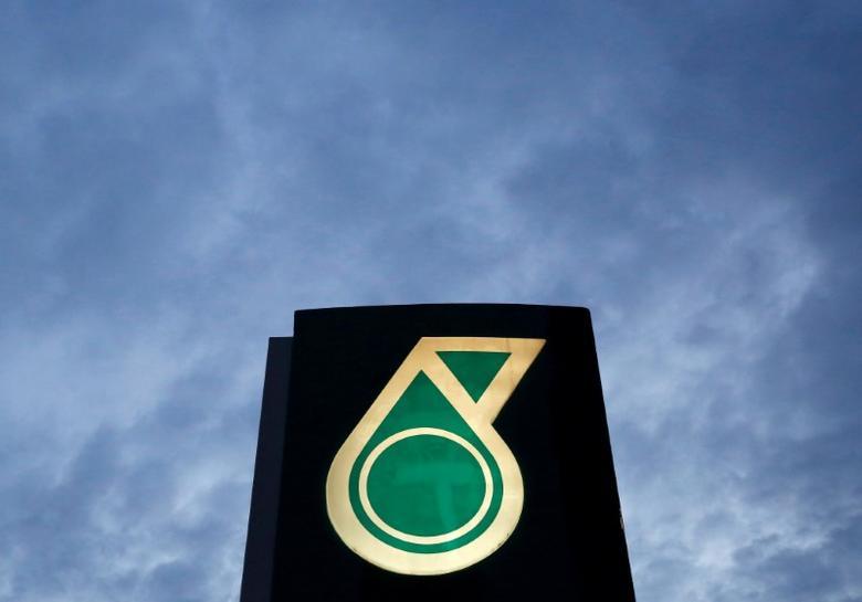 A logo of a Petronas fuel station is seen against a darkening sky in Kuala Lumpur, Malaysia February 10, 2016. REUTERS/Olivia Harris/File Photo