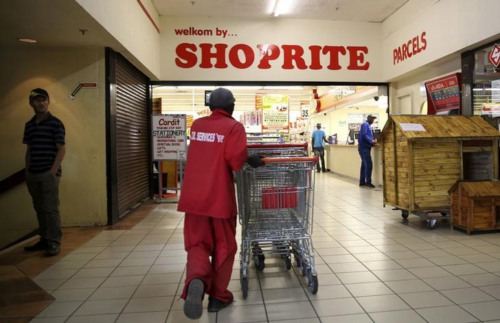 A worker pushes trolleys at the Shoprite store in Johannesburg, South Africa February 23, 2016. REUTERS/Siphiwe Sibeko/File Photo