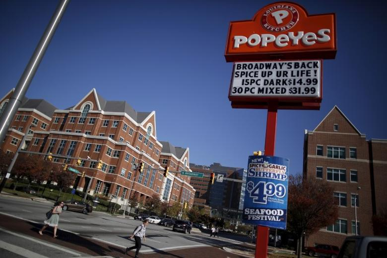 A popeyes restaurant sign is seen on the intersections of Broadway and New Orleans a cross the street from the John Hopkins Hospital in Baltimore, Maryland November 4, 2015. REUTERS/Carlos Barria