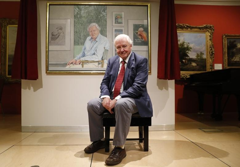 File Photo: David Attenborough poses next to a portrait of himself by Bryan Organ to mark his 90th birthday at New Walk Museum and Art Gallery in Leicester, Britain, September 22, 2016. REUTERS/Darren Staples/File Photo