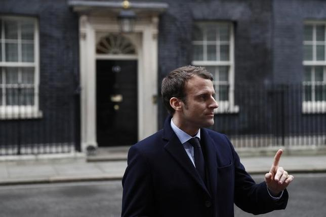 Emmanuel Macron, candidate in France's 2017 French presidential speaks to media outside 10 Downing Street in central London, Britain, February 21, 2017. REUTERS/Stefan Wermuth