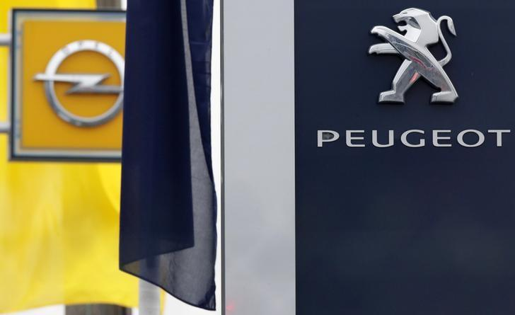 The logos of French car maker Peugeot and German car maker Opel are seen at a dealership in Villepinte, near Paris, France, February 20, 2017.   REUTERS/Christian Hartmann