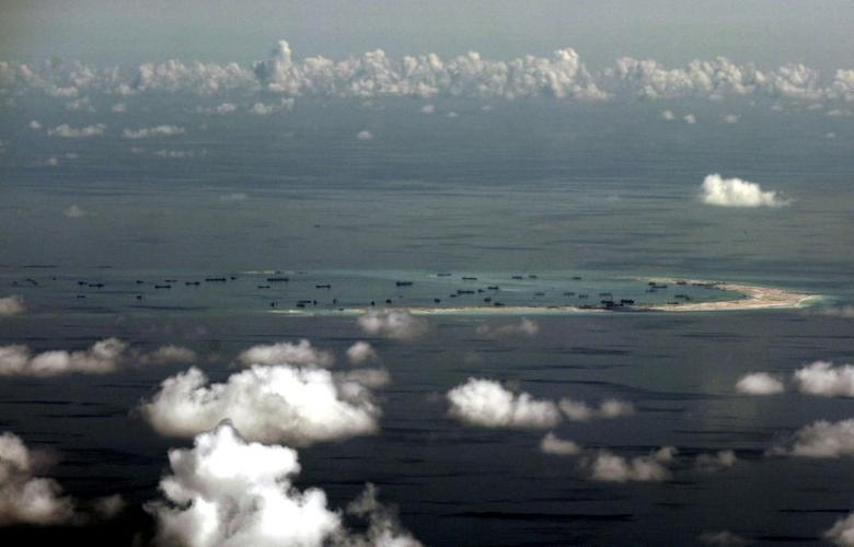 FILE PHOTO -  An aerial photo taken though a glass window of a Philippine military plane shows the alleged on-going land reclamation by China on mischief reef in the Spratly Islands in the South China Sea, west of Palawan, Philippines, May 11, 2015.  REUTERS/Ritchie B. Tongo/Pool/File Photo