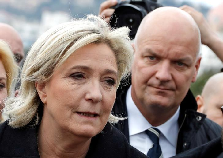FILE PHOTO - French National Front leader Marine Le Pen and presidential election candidate, walks on the Promenade des Anglais with her bodyguard Thierry Legier (R) in Nice, France February 13, 2017.    REUTERS/Eric Gaillard/File Photo