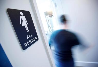 A bathroom sign welcomes both genders at the Cacao Cinnamon coffee shop in...
