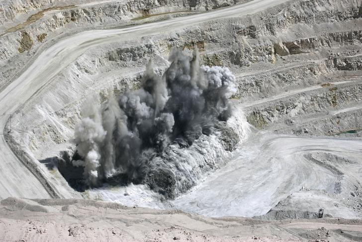 FILE PHOTO - Explosions blast rock mass at BHP Billiton's Escondida, the world's biggest copper mine, in Antofagasta, Chile March 31, 2008. REUTERS/Ivan Alvarado