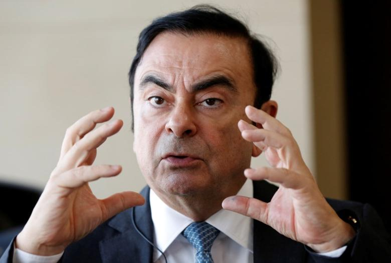 Carlos Ghosn, Chairman and CEO of the Renault-Nissan Alliance, speaks during an interview with Reuters at Nissan's global headquarters in Yokohama, Japan, February 23, 2017.  REUTERS/Toru Hanai