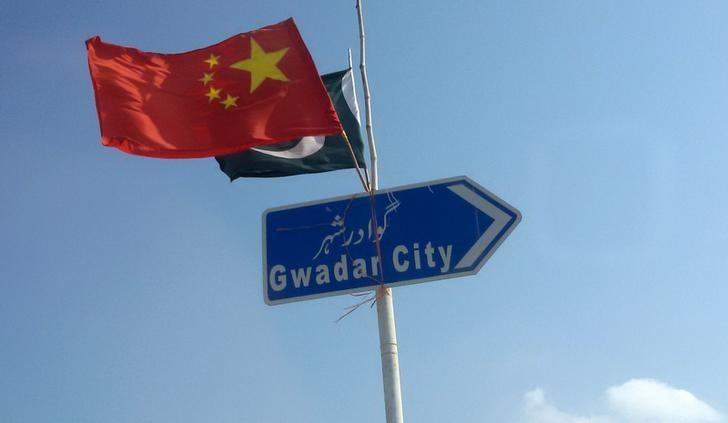 The Chinese and Pakistani flags fly on a sign along a road towards Gwadar, Pakistan January 26, 2016. Picture taken January 26, 2016. REUTERS/Syed Raza Hassan