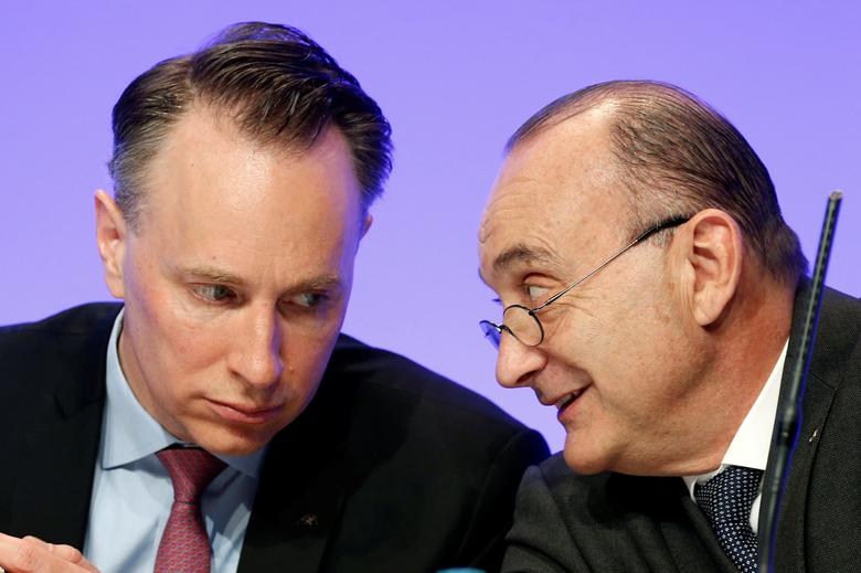 Thomas Buberl (L), CEO of AXA, speaks with AXA France Chairman and CEO Jacques de Peretti (R) during the company's 2016 annual results presentation in Paris, France, February 23, 2017. REUTERS/Charles Platiau