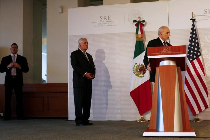 U.S. Secretary of State Rex Tillerson (C) listens as U.S. Homeland Security Secretary John Kelly (R) attends a joint news conference with Mexico's Interior Minister Miguel Angel Osorio Chong (not pictured) at the foreign ministry in Mexico City, Mexico, February 23, 2017.    REUTERS/Carlos Jasso