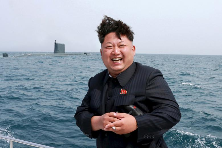 North Korean leader Kim Jong Un watches the test-fire of a strategic submarine underwater ballistic missile (not pictured), in this undated photo released May 9, 2015. REUTERS/KCNA
