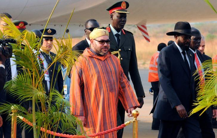 King Mohammed VI of Morocco is welcomed by South Sudan's President Salva Kiir upon arriving at the Juba airport in South Sudan's capital Juba, February 1, 2017. REUTERS/Jok Solomun