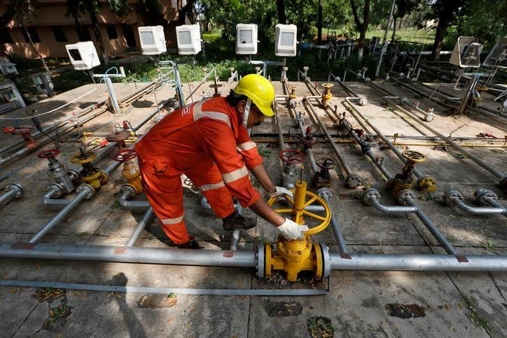 A technician works inside the Oil and Natural Gas Corp (ONGC) group gathering station on the outskirts of Ahmedabad, India, September 30, 2016. REUTERS/Amit Dave/Files