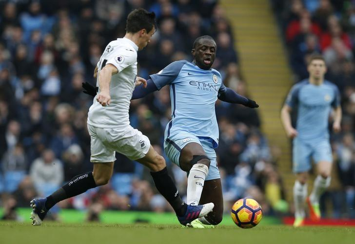 Britain Soccer Football - Manchester City v Swansea City - Premier League - Etihad Stadium - 5/2/17 Manchester City's Yaya Toure in action with Swansea City's Jack Cork Reuters / Andrew Yates/ Livepic/ Files