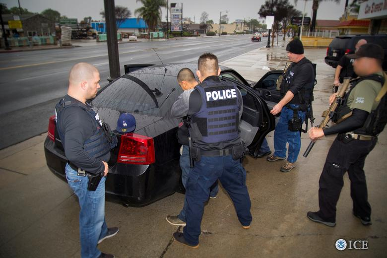 FILE PHOTO - U.S. Immigration and Customs Enforcement (ICE) officers detain a suspect as they conduct a targeted enforcement operation in Los Angeles, California, U.S. on February 7, 2017.  Courtesy Charles Reed/U.S. Immigration and Customs Enforcement via REUTERS      ATTENTION EDITORS - THIS IMAGE WAS PROVIDED BY A THIRD PARTY. EDITORIAL USE ONLY.