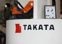 The logo of Takata Corp is seen on its display at a showroom for vehicles in Tokyo, Japan, February 9, 2017. Picture taken February 9, 2017. REUTERS/Toru Hanai
