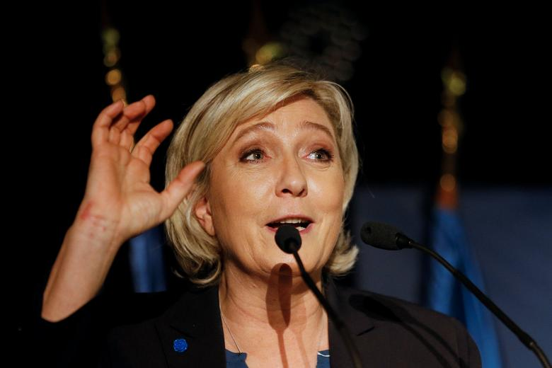 FILE PHOTO:Marine Le Pen, French National Front (FN) political party leader and candidate for French 2017 presidential election, attends a political rally in Clairvaux-les-Lacs, France, February 17, 2017. REUTERS/Robert Pratta/File Photo