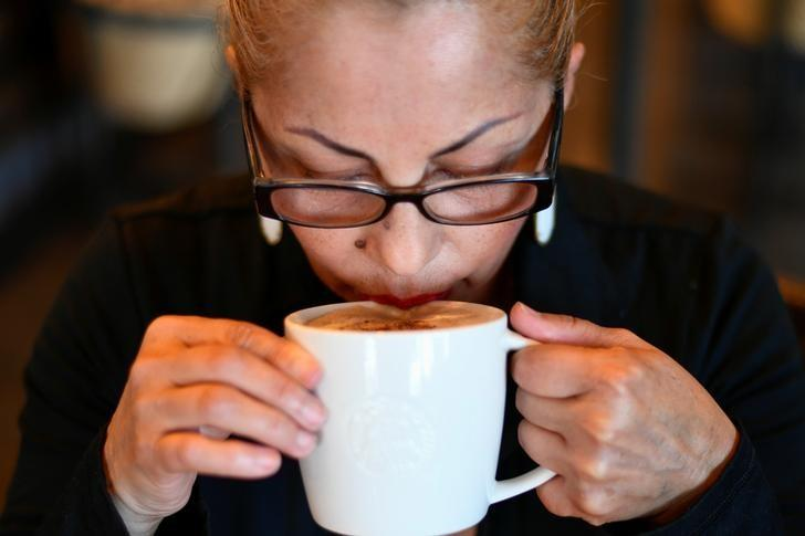 A customer sips on a coffee at a Starbucks coffeehouse in Austin, Texas, U.S., February 11, 2017. Picture taken February 11, 2017. REUTERS/Mohammad Khursheed