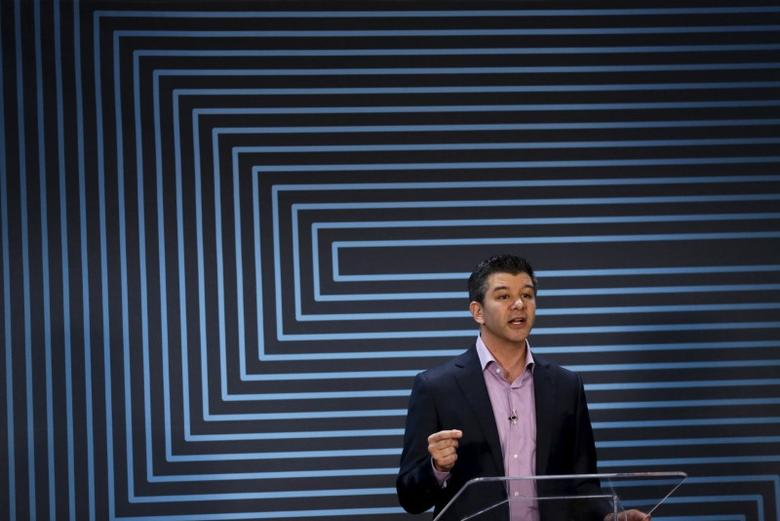 Uber CEO Travis Kalanick  gestures as he delivers an address to employees and drivers marking the company's five year anniversary in San Francisco, California June 3, 2015.  REUTERS/Robert Galbraith