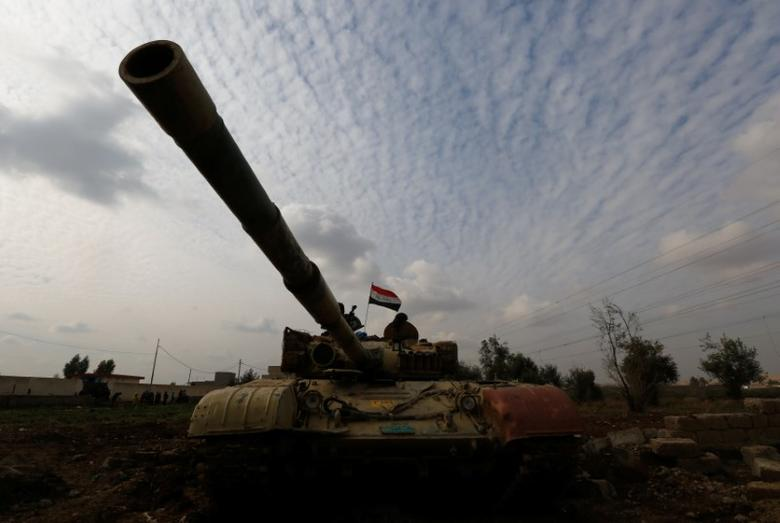 A tank of Iraqi army is seen during a fight with Islamic State militants in Rashidiya, North of Mosul, Iraq, January 30, 2017. REUTERS/Muhammad Hamed/Files